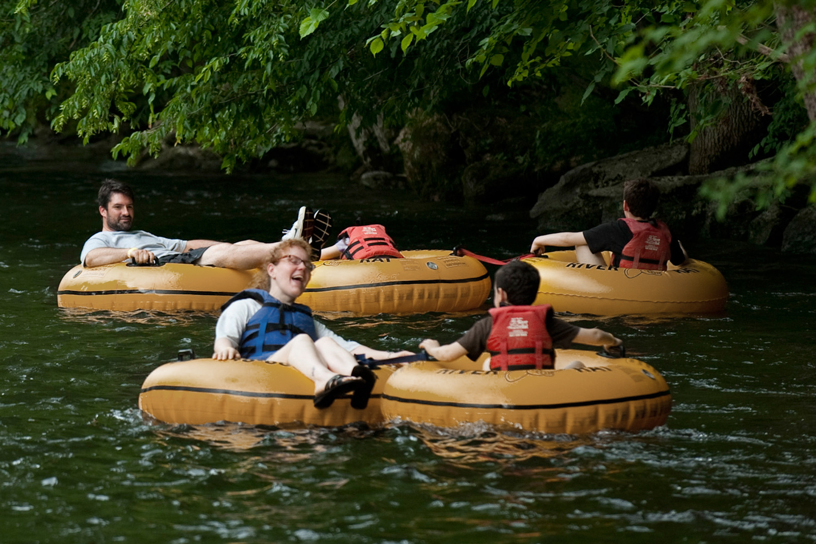 A family tubing down a river in Townsend, TN.