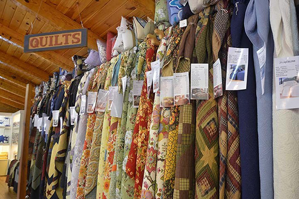 Picture of many hand made quilts