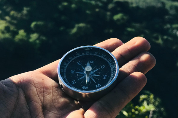 Hiking in Cades Cove with Outstretched hand holding compass