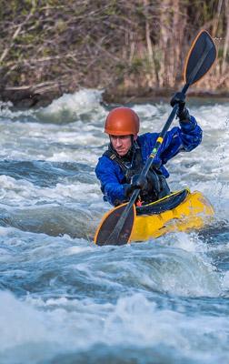 Man kayaking in river rapids in Townsend, TN.